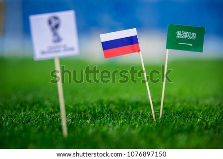 MOSCOW, RUSSIA - APRIL, 24, 2018: Russia - Saudi Arabia, Group A, Thursday, 14. June, Football, World Cup, Russia 2018, National Flags on green grass, white football ball on ground. #1076897150
