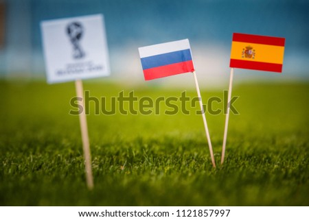 MOSCOW, RUSSIA - APRIL, 24, 2018: Spain - Russia, 16-final, eight final, 1. Junly, Football FIFA World Cup, Russia 2018, National Flags on green grass, white football ball on ground. Play-off #1121857997