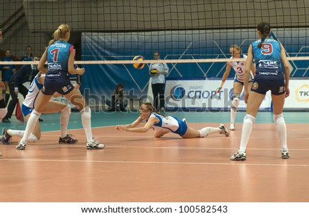 MOSCOW, RUSSIA - APRIL 13: Unidentified players in action a Russian Championship woman's volleyball game Dynamo Russia (blue) vs Dynamo (Kazan) (white) on April 13, 2012 in Moscow, Russia.