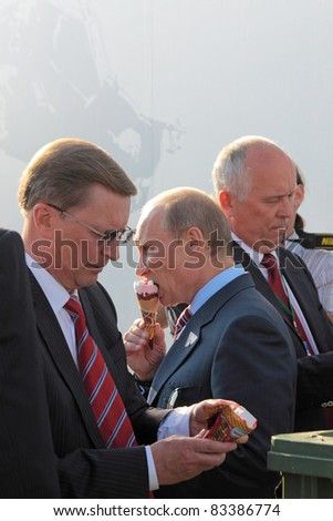 MOSCOW, RUSSIA - AUG 17: Vladimir Putin, Prime Minister and Sergei Ivanov secretary of the Security Council at the International Aviation and Space salon MAKS. Aug 17, 2011 at Zhukovsky, Russia
