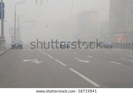 MOSCOW, RUSSIA - AUGUST 7: Cars run down Prospekt Mira Avenue in thick smog August 7, 2010 in Moscow, Russia