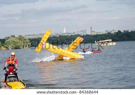 """MOSCOW, RUSSIA- AUGUST 07: Crazy flight day """"Red Bull Flugtag 2010"""", an airplane hits the water on August 7, 2011 in Moscow, Russia"""
