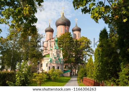 MOSCOW, RUSSIA - AUGUST 28, 2018: Ivan Lestvichnik Cathedral, Mother of God Cathedral and trees at Donskoy Monastery in Donskaya Street. This monastery was founded in 1591. #1166306263