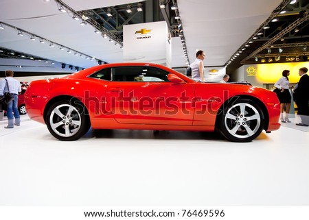 MOSCOW, RUSSIA - AUGUST 25:  Red sport car Chevrolet Camaro on display at Moscow International exhibition InterAuto on August 25, 2010 in Moscow, Russia.