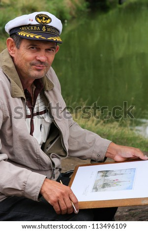 MOSCOW, RUSSIA - AUGUST 18: Unidentified painter shows its drawing of Novodevichy Convent, in August 18, 2012 in Moscow, Russia. Novodevichy was proclaimed a UNESCO World Heritage Site in 2004.