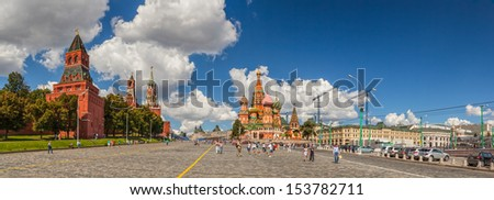 MOSCOW, RUSSIA - AUGUST 17: View to Red Square, Spasskaya tower, Saint Basil Cathedral under clouds on August 17, 2013 in Moscow, Russia. Red square is the famous touristic place to visit. - stock photo