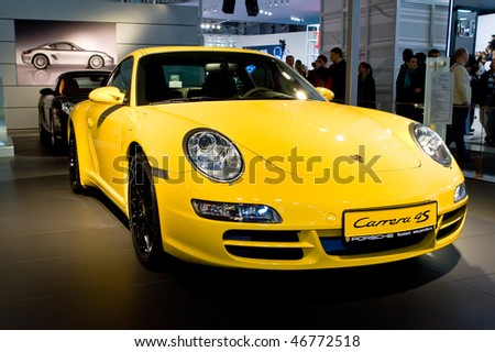 MOSCOW, RUSSIA - AUGUST 27: Yellow sport car Porsche Carrera at Moscow International exhibition InterAuto on August 27, 2008 in Moscow, Russia.