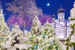 Moscow. Russia. Church in the park zaryadye. Christmas trees near the temple. Church of the conception of st. Anne on a winter. Moscow on Christmas night. Orthodox Church on Moskvoretskaya Embankment