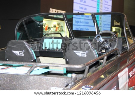 Moscow / Russia – 03 08 2018: Cockpit view of Russian blue aluminium motor boat Berkut M series on stand Mercury at the Yacht exhibition Moscow Boat show MBS 2018 in Crocus Expo #1216096456