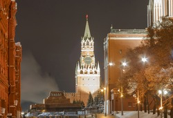 Moscow, Russia.   Evening view of  Spasskaya tower of the Moscow Kremlin and part of the Red Square. Evening. Long focal length.