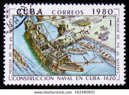 """MOSCOW, RUSSIA - FEBRUARY 12, 2017: A stamp printed on Cuba shows construction of the Cuban galleon """"Nuestra Senora de Atocha"""" (Our lady of Atocha), built in 1620, circa 1980"""