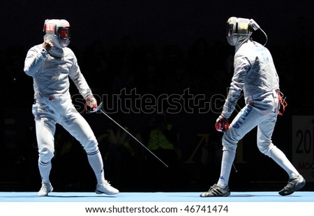 MOSCOW, RUSSIA - FEBRUARY 13: Eun Sok Oh (KOR) and Luigi Samele (ITA) compete at the 2010 RFF Moscow Saber World Fencing Tournament, February 13, 2010 in Moscow, Russia.