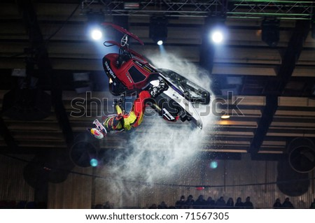 MOSCOW, RUSSIA - FEBRUARY 13: FMX rider Daniel Bodin performs trick backflip on snowmobile at festival of Extremals sports at Lugniki February 13, 2011 in Moscow, Russia