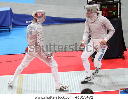 MOSCOW, RUSSIA - FEBRUARY 14: Nikolay Kovalev (RUS) and Aldo Montano (ITA) compete at the 2010 RFF Moscow Saber World Fencing Tournament, February 14, 2010 in Moscow, Russia.
