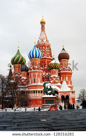 MOSCOW. RUSSIA - FEBRUARY 02: People walking on the Red Square, by St. Basil Cathedral. UNESCO World Heritage Site.  on February 02, 2013 in Moscow, Russia. - stock photo