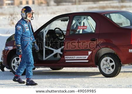 """MOSCOW, RUSSIA - FEBRUARY 23: Racing driver Firdaus Kabirov during the 21st traditional """"Race Stars"""" Za rulyom """"on the ice road in Tushino, February 23, 2010 in Moscow, Russia."""