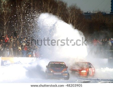 """MOSCOW, RUSSIA - FEBRUARY 23: 21st traditional """"Race Stars""""Za rulyom"""" on the ice road in Tushino (racing drivers: David Coulthard, Vitaly Petrov, Firdaus Kabirov), February 23, 2010 in Moscow, Russia."""