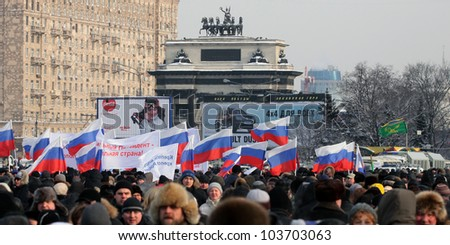 MOSCOW, RUSSIA, FEBRUARY 04 - The citizens go to the meeting for supporting of Vladimir Putin with russian three-colors flags on February 04, 2012 in Moscow