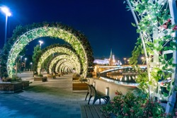 Moscow. Russia. Flower arches on the shore of the Kremlin embankment. Decoration of Moscow at night. Flowers on the evening promenade. Flower arches glow at night. Vacations in Russia.