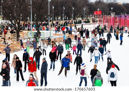 MOSCOW, RUSSIA - JANUARY 2, 2013: crowds of townsfolk skating rink on ice covered paths in Gorky Central Park on winter weekends. This is Europe\'s largest artificial ice rink area 18 000 sq m