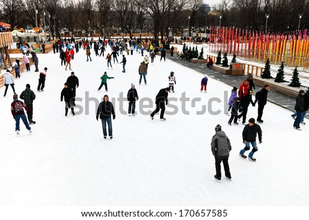 MOSCOW, RUSSIA - JANUARY 2, 2013: people skating rink on ice covered paths in Gorky Central Park on winter weekends. This is Europe\'s largest artificial ice rink area 18000 sq m