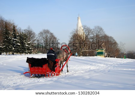 ... Russian winter fun. Ascension cathedral seen at background. Taken on