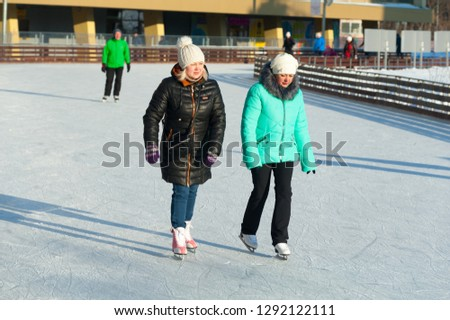 MOSCOW, RUSSIA - JANUARY 22, 2019: Two women skating in VDNKh on winter sunny day. VDNKh is permanent general purpose trade show and amusement park. #1292122111
