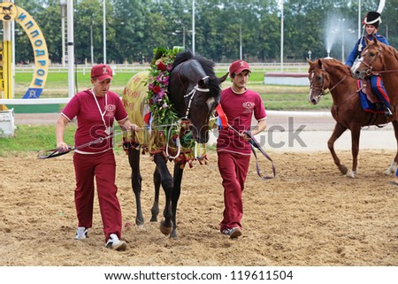 "MOSCOW, RUSSIA - JUL 07: The races for the prize of the President of the Russian Federation, horse that won the prize of the ""National treasure"" on Jul 07, 2012 in Moscow."