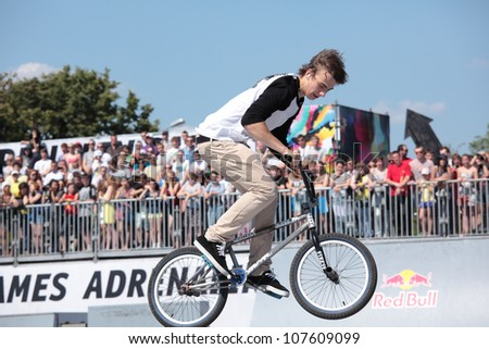 MOSCOW, RUSSIA - JULY 8: Denis Stepanov in BMX competitions during Adrenalin Games in Moscow, Russia at July 8, 2012