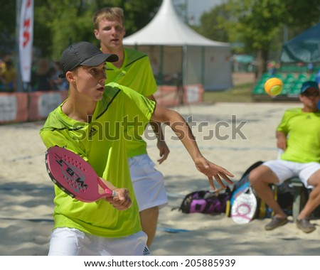 MOSCOW, RUSSIA - JULY 17, 2014: Men team Lithuania in the match with Israel during ITF Beach Tennis World Team Championship. Lithuania won the round