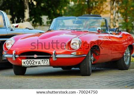 MOSCOW, RUSSIA-JULY 31: Red Jaguar E-Type. Modelyear 1963, on exhibition parking at annual 'Night Moscow Classic Rally'. The sixth race of vintage cars, more than 50 crews, from owners to showstars