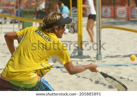 MOSCOW, RUSSIA - JULY 16, 2014: Vinicius Font of Brazil on the training before the ITF Beach Tennis World Team Championship. Russia hosts the championship for the third time