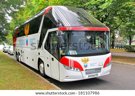 MOSCOW, RUSSIA - JULY 7, 2012: White Neoplan N5217/3SHD Starliner coach of the Russia Football team at the city street.