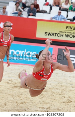 MOSCOW, RUSSIA - JUNE 8: Anastasia Vasina (left) and Anna Vozakova (center), Russia vs Meppelink - van Gestel, Netherlands, during Beach Volleyball Swatch World Tour in Moscow, Russia at June 8, 2012