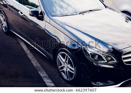 Moscow, Russia- June 12, 2017:  Black Mercedes Benz on the street toned with glare of the sun #662397607