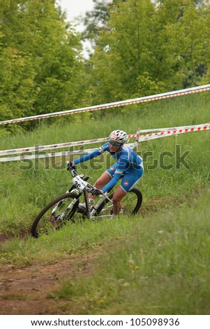MOSCOW, RUSSIA - JUNE 7: Eva Lechner (Italy) in team relay during European Mountain Bike Cross-country Championship in Moscow, Russia at June 7, 2012.