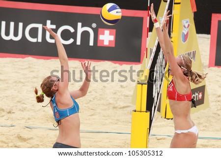 MOSCOW, RUSSIA - JUNE 8: K. Kolocova (left) and M. Slukova, Czech Republic vs E. Ukolova (right) and E. Khomyakova, Russia, during Beach Volleyball Swatch World Tour in Moscow, Russia at June 8, 2012