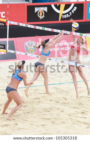 MOSCOW, RUSSIA - JUNE 8: Kolocova (center) and Slukova (left), Czech Republic vs Ukolova and Khomyakova (right), Russia, during Beach Volleyball Swatch World Tour in Moscow, Russia at June 8, 2012