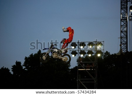 MOSCOW, RUSSIA - JUNE 26: Red Bull X-Fighters FMX competition on Red Square Nate Adams performs scorpion, 26 June, 2010 in Moscow, Russia - stock photo