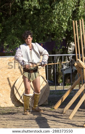 MOSCOW, RUSSIA - JUNE 7, 2015: Roman gladiator in the arena with javelin in his hand at Times and Epochs: Rome historical festival