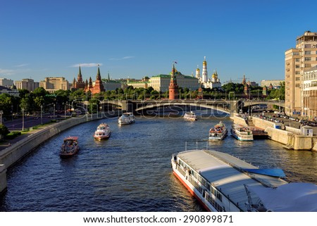Moscow Russia JUNE 12 2015 Summer ships traffic on Moscow river near the Kremlin Moscow Russia June 12 2015