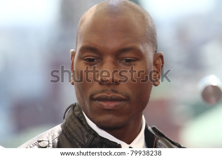 MOSCOW, RUSSIA - JUNE 23: Tyrese Gibson poses for a photocall before global premiere of 'Transformers 3' movie on the roof of the Ritz hotel on June 23, 2011 in Moscow, Russia