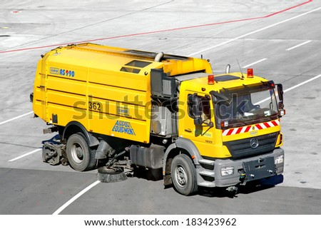 MOSCOW, RUSSIA - JUNE 4, 2012: Yellow Mercedes-Benz Axor 1823 washing and cleaning machine at the Vnukovo international airport.