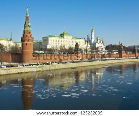 Moscow, Russia, Kremlin fortress with palace and cathedrals on bank of Moscow-river in spring, ice on water.