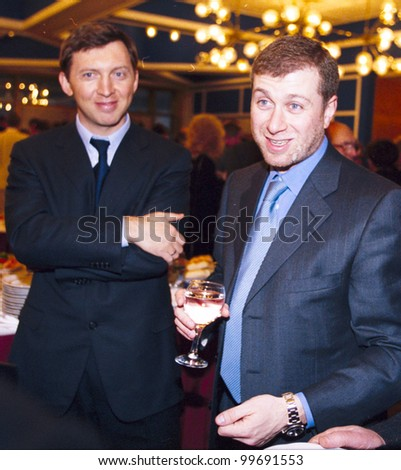 MOSCOW, RUSSIA - MAR 29: Russian oligarch Oleg Deripaska, left, and Roman Abramovich, attend a meeting between Russian president Vladimir Putin and Russian businessmen in the Kremlin on Wednesday, March 29, 2006.
