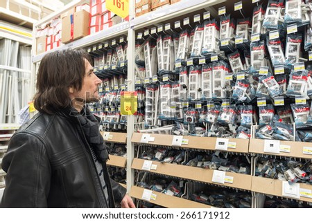 MOSCOW, RUSSIA - MARCH 03, 2015. A man makes a purchase of Leroy Merlin Store. Leroy Merlin is a French home-improvement and gardening retailer serving thirteen countries