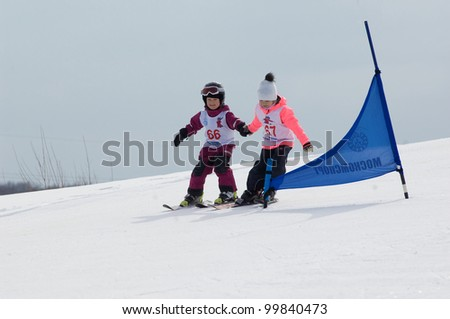 """MOSCOW, RUSSIA - MARCH 31: Hisyametdinova M.(66) and Hitrova T.(67) at closing winter season competition on March 31, 2012 in Peredelkino, Moscow, Russia. Competition calls """"down the hill by pears"""""""