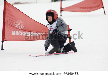 MOSCOW, RUSSIA - MARCH 31: Kureneva Polina(45) falls down at closing winter season competition on March 31, 2012 in Peredelkino,Moscow,  Russia. Competition is skiing on a one ski - stock photo