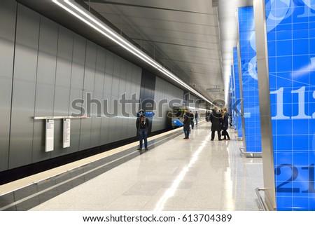MOSCOW, RUSSIA - MARCH 24, 2017: Lomonosovsky Prospekt is station on Kalininsko-Solntsevskaya Line of Moscow Metro. It opened on 16 March 201. Train arrives at station. #613704389