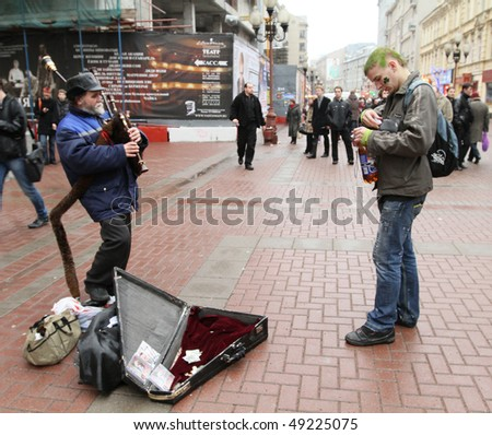 MOSCOW, RUSSIA - MARCH 21: On Arbat Street marking St. Patrick's Day, it has recently become a tradition in Moscow to mark the Irish holiday, March 21, 2010 in Moscow, Russia. - stock photo